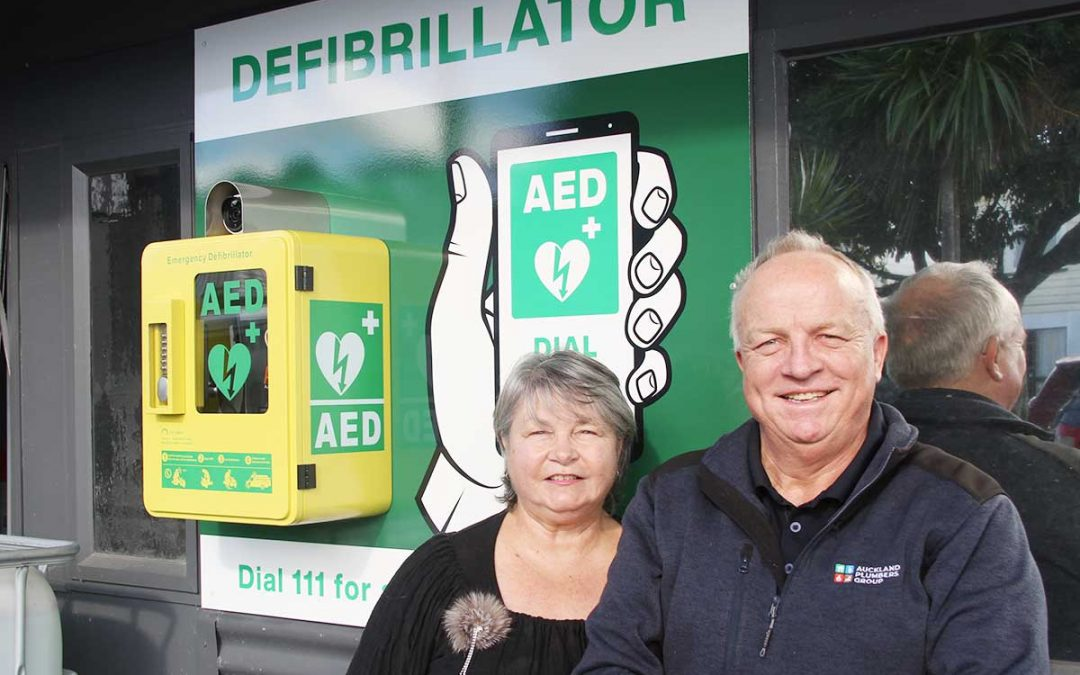 Kay and Andrew Durrans beside defibrillator